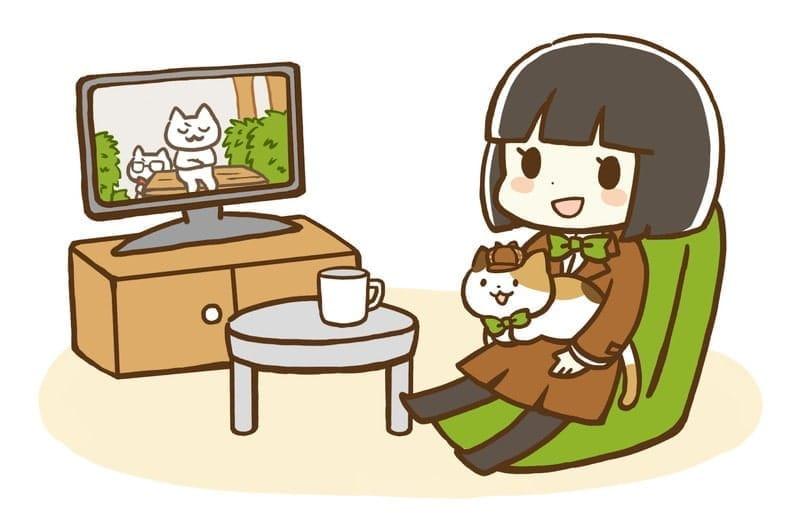テレビを見ている女の子と猫